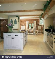 Limestone Flooring In Kitchen White Island Unit In Openplan Kitchen And Dining Room With