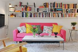 college living room decorating ideas. Cute College Girl Apartment Living Room Decorating Ideas With Pink Microfiber Sofa On Grey Carpet And Wall Mounted Book Rack