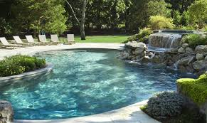 Swimming Pool:Natural Outdoor Swimming Pools Design With Wooden Deck And  Fountain Idea Natural Swimming
