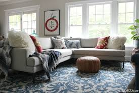 visualize before ing use painters tape on the floor to determine if the rug is the right size