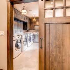 laundry room with barn door