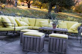 sofa on outdoor patio featuring cushions with green sunbrella fabric