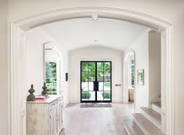 front doors with glass curved ceiling curved entryway distressed cabinets entry rug foyer glass double door