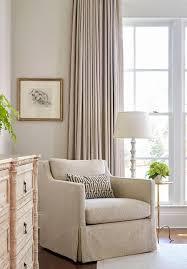 Elegant Bedroom Reading Corner with Skirted Herringbone Chair and  Whitewashed Floor Lamp