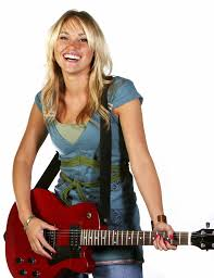 A blonde haired lady holding a guitar