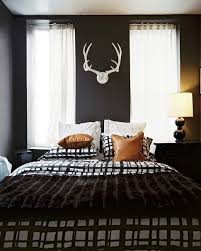 Men Bedroom Design Bedroom Mens Bedroom Design With Black Walls Feat White Antlers
