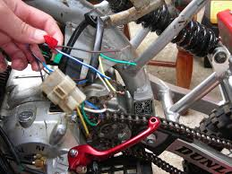 wiring diagram for loncin 110cc all these wires in the picture are the ones that im not using i beleive they got to do the electric start so if your taking that if theres are some