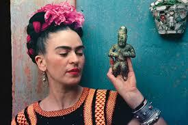 save frida kahlo with olmec figurine 1939