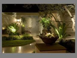 home wall lighting design home design ideas. Exterior: Shiny Wall Lamp Under Cute Tree Front Fresh Grass Right For Modern Outdoor Lighting Home Design Ideas H