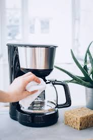 Cleaning a coffee maker with vinegar. How To Clean A Coffee Maker For A Better Tasting Brew Hello Nest