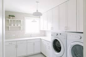 All White Laundry Room with Half Tiled Backsplash