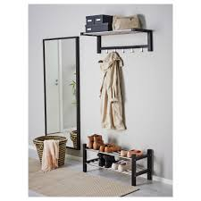 gorgeous home mudroom design featuring wall mounted vertical mirror and rattan basket also two