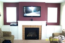 wall mounted tv where to put cable box above fireplace where to put cable box heat