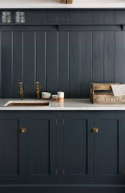 navy shaker cabinets marble counter top brass latch hardware