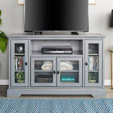 highboy tv stand entertainment center with adjule shelving behind glass paned doors