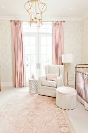 inside a perfectly elegant pink and gold nursery