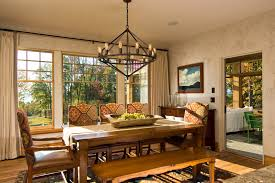 marvelous edison light fixtures in dining room rustic with honey oak trim next to textured wall alongside modern spanish and table runner