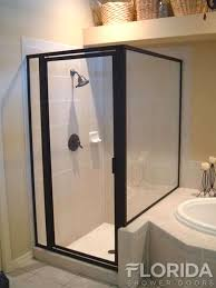 framed glass shower enclosure with a panel on a rise and oil rubbed bronze hardware