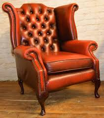 chesterfield oxblood red queen anne wingback armchair tub vintage chairs leather antique seating club lounge vinterior