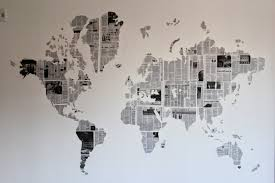 Once all your newspaper is up, remove the computer paper guide to reveal  your newspaper map wall art!