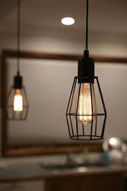 wire cage pendant light. Black Wire Cage Pendant Light Hanging Over A Kitchen Bench F