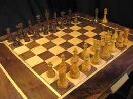 hand carved turned chess pieces with chess table
