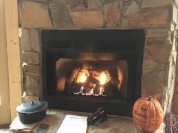 the fireplace has a louvered front should this hood be installed even with the louvers or up above the louvers i e at the top of the fireplace closer to