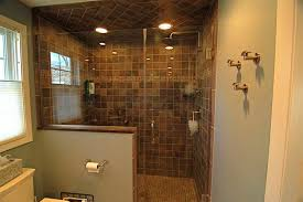 shower lighting ideas. add bright lighting for dim shower space with stone tile ideas and glass door