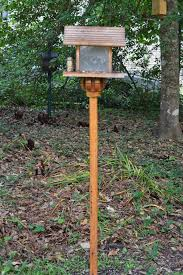 the feeder is holding suet blocks on the side