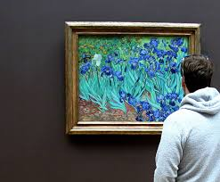 a visitor contemplates van gogh s irises in the galleries of the j paul getty museum