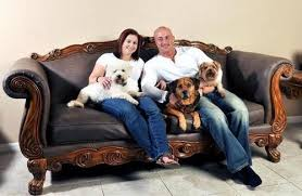 Kris Rotonda  who founded YouMustLoveDogsDating com  poses with his girlfriend Denise Fernandez and three of his four dogs   Rebecca Brittain Associated     Yahoo