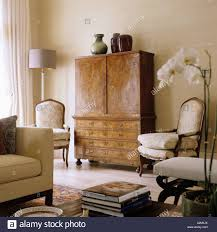 Walnut Furniture Living Room Antique Walnut Cabinet And Louis Xv Chairs In Living Room Of