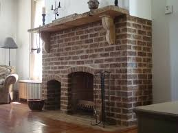 red blood bricked stone style feeg fireplace firebox vintage design with unfurnished wood mantel just above the fireplace to place some ornaments like
