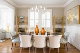 elegant faux magnolia centerpiece for transitional dining room with wood floors transitional dining room chandelier
