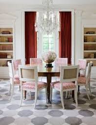 a dramatic swathe of red and coordinating fabric on the chairs to liven up this otherwise neutral dining room