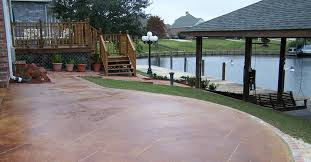 amazing reddish tone outdoor flooring idea with curve style aside lake with roof and porch aside amazing stone flooring idea over concrete