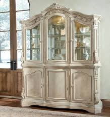 decorative corner dining room hutch and classic glass door with white rug
