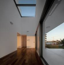 wooden floor in modern house with spacious feeling wooden flooring also white wall used glass