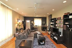 recessed lighting with ceiling fan for small family room decorating ideas with black wall bookcase and white curtains
