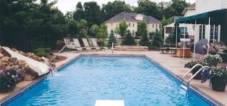 Image Backyard Pool 10 Pool Area Decorating Ideas That Will Make Your Backyard Hit This Summer Charlotte Fiberglass 10 Pool Area Decorating Ideas That Will Make Your Backyard Hit