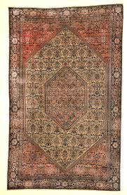 antique sarouk farahan with medallion and ivory pink and red detail genuine authentic woven carpet art