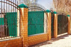 modern metal fence design. Brick And Metal Fence With Door Gate Of Modern Style Design Ideas.