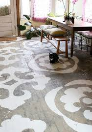 View in gallery old-wood-floor-stenciled-directly-onto-wood-london.