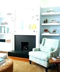 floating shelves around tv built in fireplace a