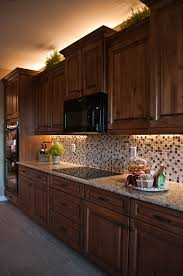 inspired led lighting in traditional style kitchen warm white leds under cabinet above crown