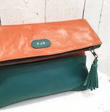 tan teal cross bag