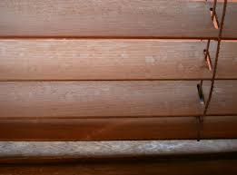 water damaged discolored timber venetians
