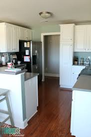white painted kitchen cabinets before and after. DIY Painted Kitchen Cabinets With Benjamin Moore Simply White Before And After