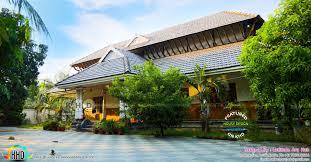 5 bedroom sloping roof traditional nalukettu kerala home