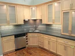 maple cabinets natural with granite kitchen white countertops black